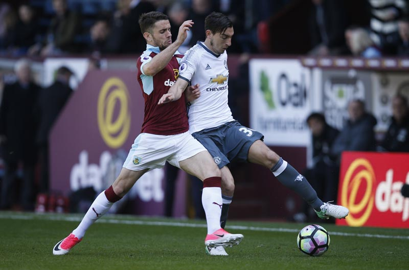 Manchester United's Matteo Darmian in action with Burnley's Robbie Brady. Photo: Reuters