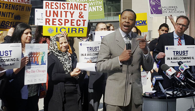 In this April 24, 2017 photo, Pastor Don Taylor, of a suburban Chicago organizing group, speaks to immigrant rights advocates in downtown Chicago. Photo: AP