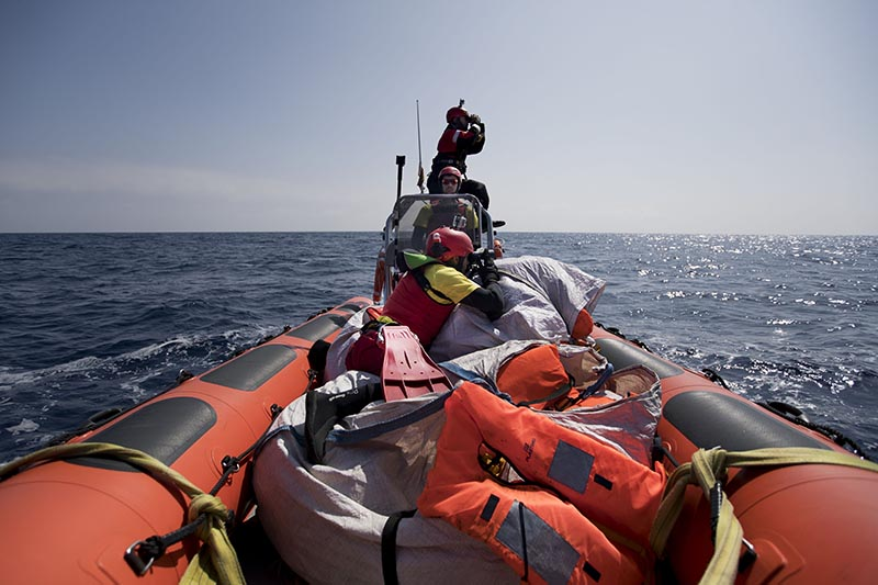 Proactiva Open Arms crew conduct a search and rescue operation in the Mediterranean sea, 12 nautic miles from the Libyan coast, on Thursday, April 13, 2017. Photo: AP
