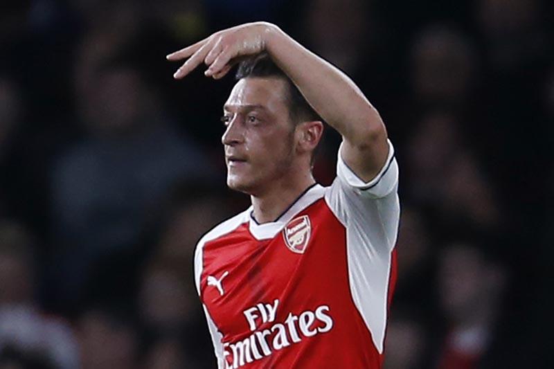 Arsenal's Mesut Ozil celebrates scoring their first goal. Photo: Reuters