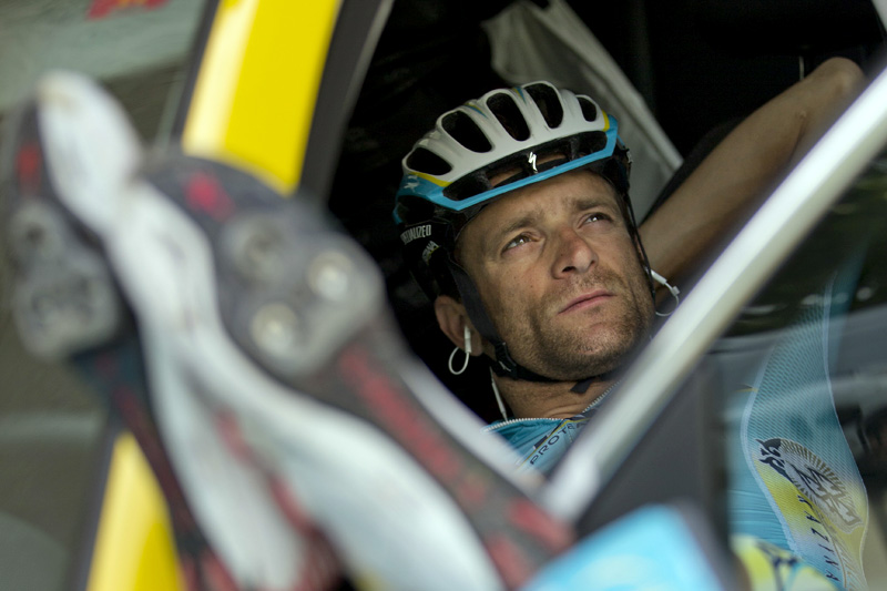 FILE - In this July 21, 2014 file photo, Italy's Michele Scarponi takes a break in a team car as he waits for the rest of the Astana team with overall leader Italy's Vincenzo Nibali, to go for a training on the second rest day of the Tour de France cycling race in Lignan-sur-Orb, southern France. Photo: AP