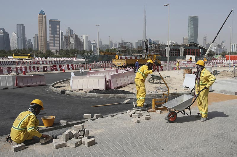 In this Monday, April 10, 2017 photo, a few labourers work on the road construction site in Dubai, United Arab Emirates. Photo: AP