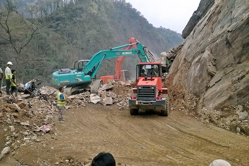 FILE: Excavators being used to clear dry landslide debris along the Muglin-Narayangadh road section, on Monday, April 3, 2017. Photo: Tilak Ram Rimal