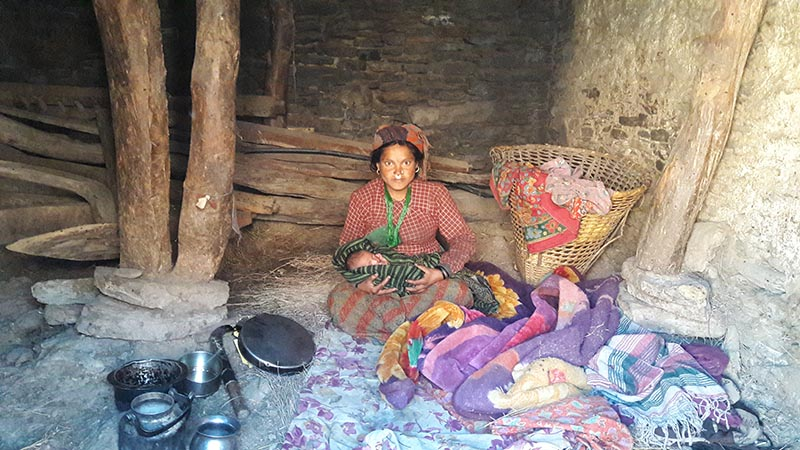 A woman with her newborn in a cowshed at Hyalung, Mugu, on Thursday, April 6, 2017. Photo: THT
