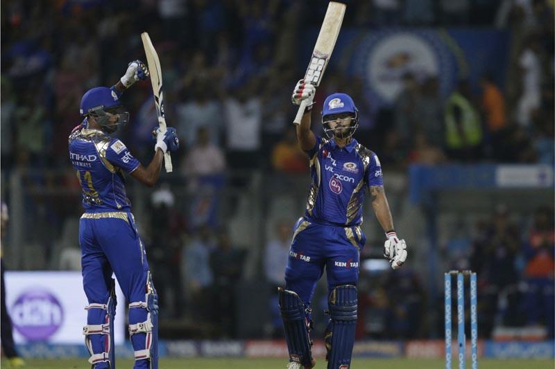 Mumbai Indians batsman Nitish Rana (right), raises his bat after score 50 runs with his team player Hardik Pandya (left), during their Indian Premier League (IPL) cricket match against Kolkata Knight Riders in Mumbai, India, on Sunday, April 9, 2017. Photo: AP