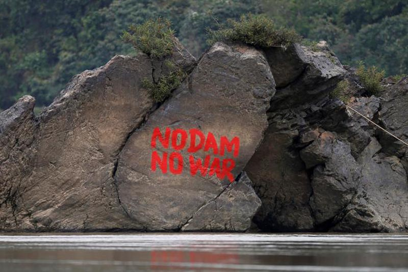A graffiti is seen on a stone at the confluence of the Mali and Nmai river at Myitsone, outside Myitkyina, capital city of Kachin state, Myanmar March 30, 2017. Photo: Reuters
