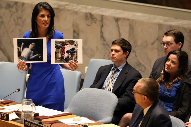 US Ambassador to the United Nations Nikki Haley holds photographs of victims during a meeting at the United Nations Security Council on Syria at the United Nations Headquarters in New York. Photo: Reuters