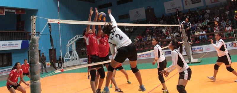 A player from NPC goes up for a spike against TAC during  their third RBB-NVA Women and Men Club League Volleyball Tournament Match in Kathmandu, on Tuesday, April 11, 2017. Photo: THT