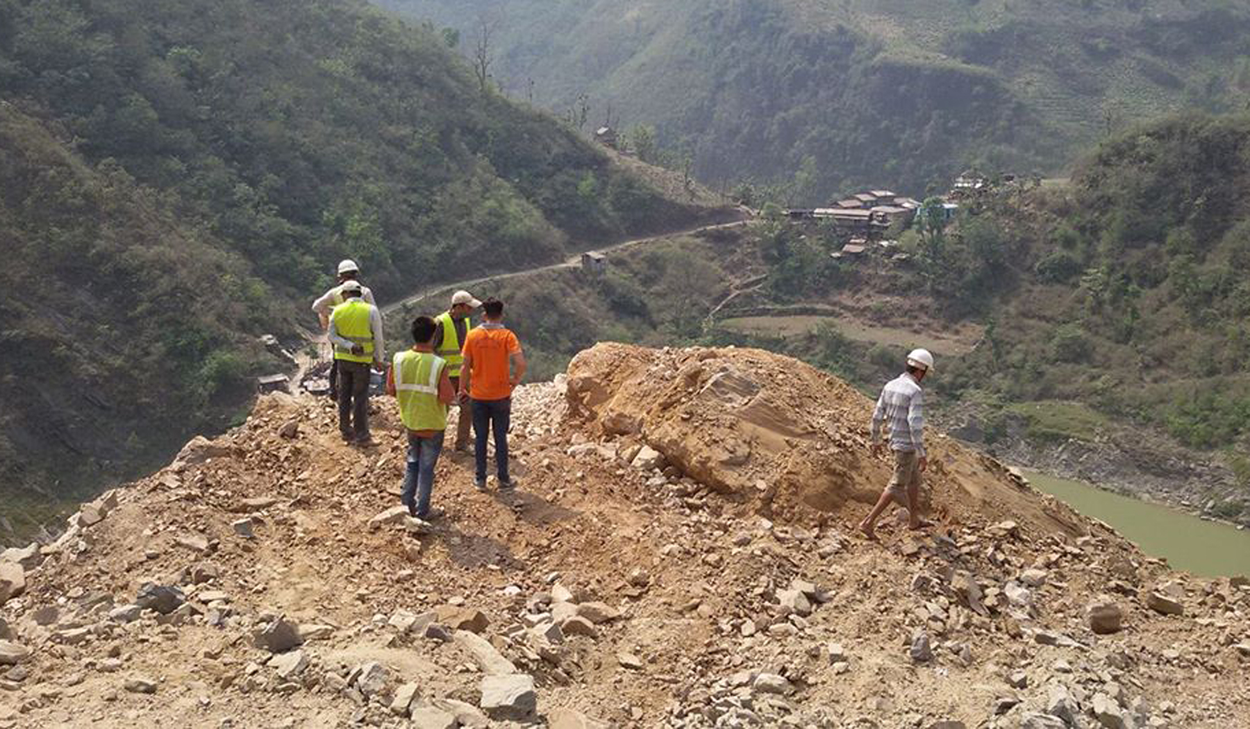 A team of technicians inspects a site at Ghumaune along the Narayangadh-Muglin road, on Wednesday, April 19, 2017. The ongoing road expansion has been brought to a halt to remove a spur that is at risk of falling. Photo: RSS