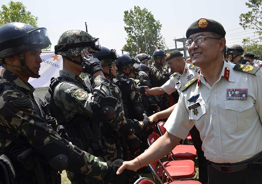 Maj Gen Binod Kumar Shrestha of Nepal Army shakes hands with the participants of Nepal-China joint military exercise. Photo: Nepal Army