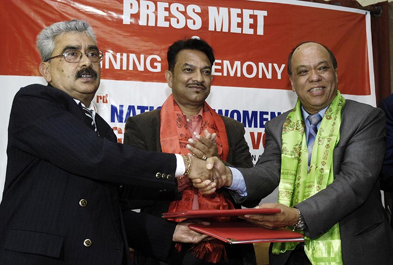 NVA President Manoranjan Raman Sharma (left) exchanges MoU with RBB CEO Kiran Kumar Shrestha as RBB Chairman Dr Ravindra Prasad Pandey looks on during a signing ceremony in Kathmandu on Sunday, April 02, 2017. Photo: Naresh Shrestha/THT