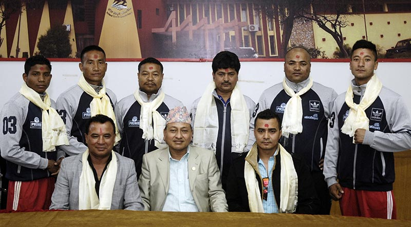 Boxers and officials with National Sports Council Member Secretary Keshab Kumar Bista (centre) and Nepal Boxing Association President Ram Awale (left) during a farewell programme in Lalitpur on Sunday, April 2, 2017. Photo: THT