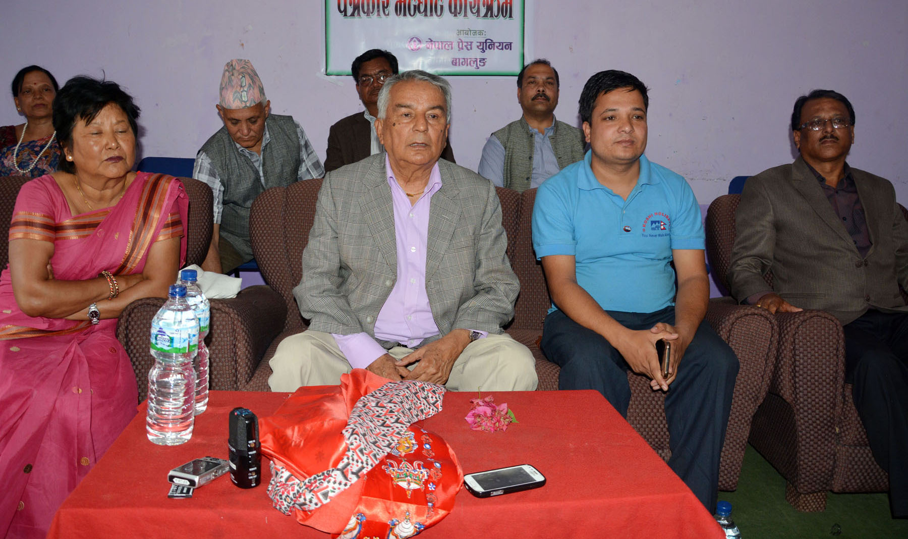 Nepali Congress senior leader Ram Chandra Paudel (c) speaks with journalists in Baglung, on Sunday, April 16, 2017. Photo: RSS