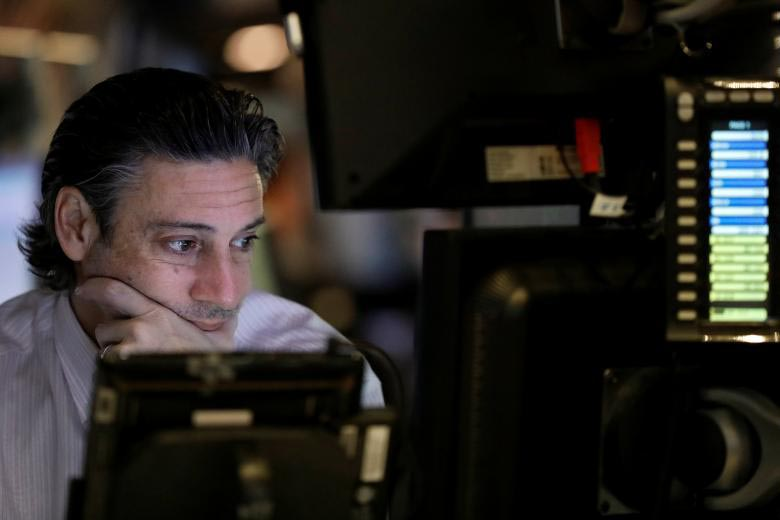 A trader works on the floor of the New York Stock Exchange (NYSE) before the opening bell in the Manhattan borough of New York, US April 4, 2017. Photo: Reuters