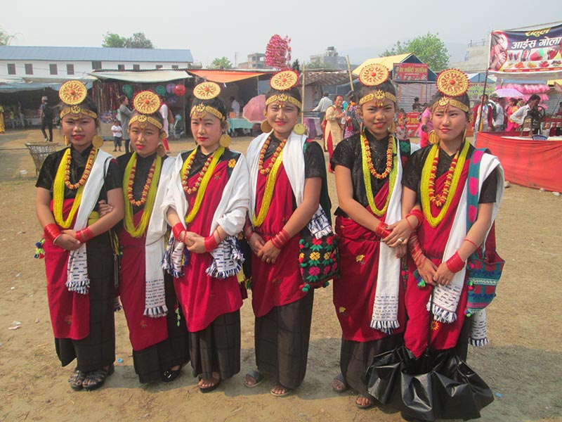 Women Artist from Nepal Magar Association Shuklagandaki  pose for a photo before performing Kaura Dance on the 12th day of Ninth Khairenitar Festival, in Damauli, Tanahun district, on Friday, April 14, 2017. Photo: Madan wagle