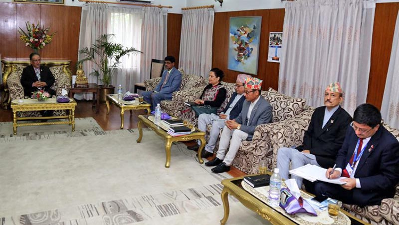 PM Dahal holding consultations on loca level elections with Election Commissioners at Baluwatar. Photo: PM's Secretariat