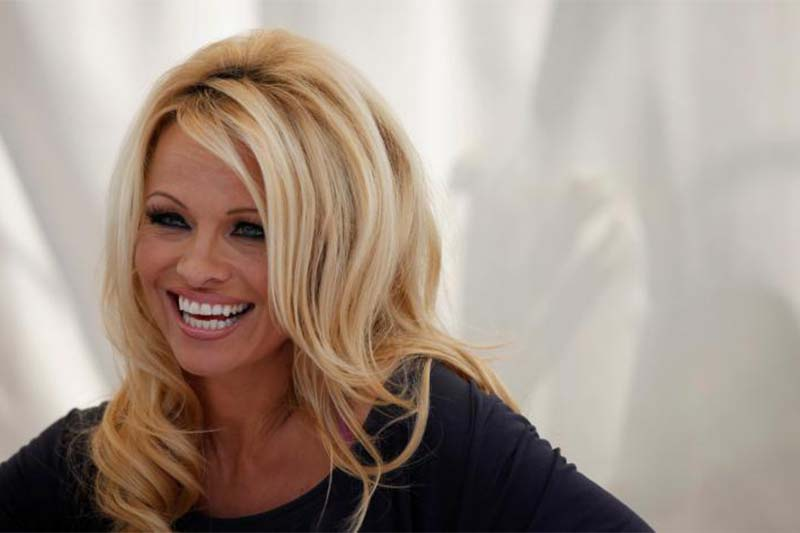 Actress Pamela Anderson answers a question at a news conference to announce the launch of the online social platform FrogAds.com, in West Hollywood, California, on March 22, 2012. Photo: Reuters