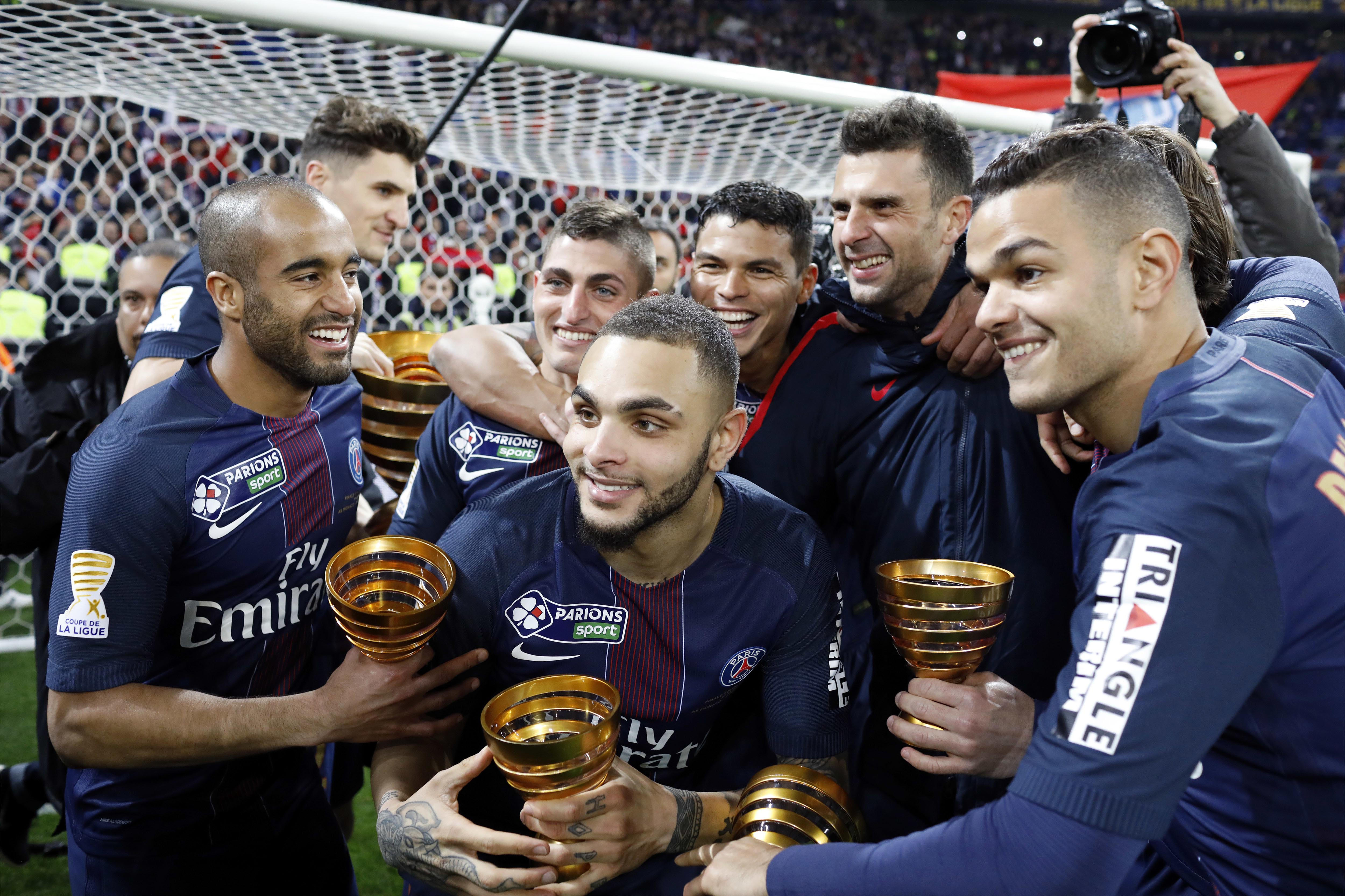 Paris Saint Germain's Layvin Kurzawa, center, celebrates with his teammates after winning the League Cup final soccer match against Monaco, in Decines, near Lyon, central France, on Saturday, April 1, 2017. Photo: AP