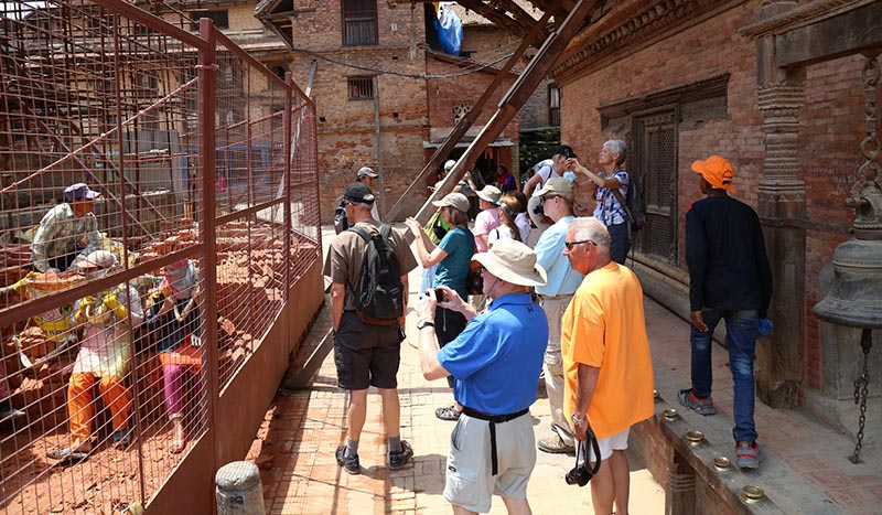 Tourists visit buildings in renovation in Patan Durbar Square, Lalitpur, on Saturday, April 29, 2017. Photo:RSS
