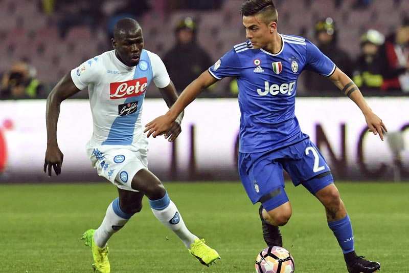 Napoli's Kalidou Koulibaly (left), challenges Juventus' Paulo Dybala during an Italian Cup, return-leg, semifinal soccer match, at the San Paolo Stadium in Naples, Italy, on Wednesday, April 5, 2017. Photo: Ciro Fusco/ANSA via AP/File