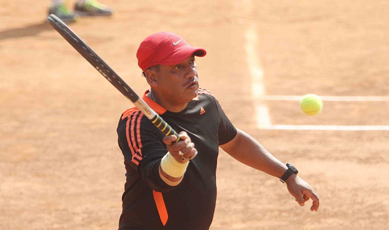 Pradeep Shah returns to Pratap Moktan during their Above-45 veteran singles semi-final match of the fifth nCitizens Bank Open Tennis Tournament at the Dasharath Stadium in Kathmandu on Thursday, April 27, 2017. Photo: THT