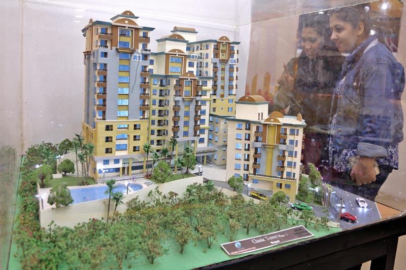 Visitors observe a replica of a high-rise at the Property Expo-2017 in Bhrikutimandap, Kathmandu, on Sunday, April 9, 2017. Photo: RSS