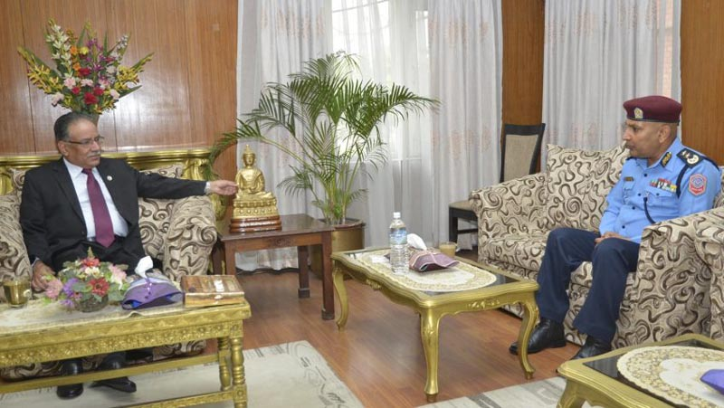 IGP Prakash Aryal meeting with Prime Minister Pushpa Kamal Dahal at his residence in Baluwatar,  on Tuesday, April 11, 2017. Photo: PM's secretariat