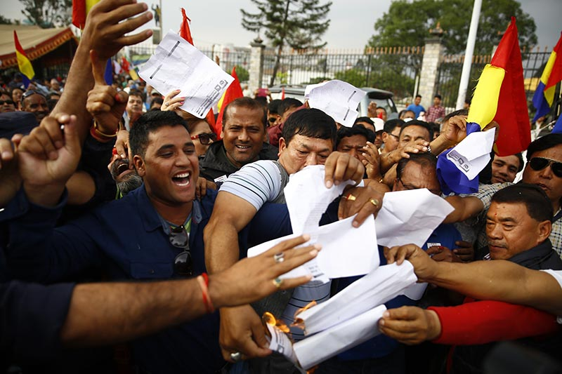 Rastriya Prajatantra Party cadres burn a copy of Election Commissionu2019s decision on the partyu2019s statute during a protest in Kathmandu on Tuesday, April 18, 2017.Photo: Skanda Gautam