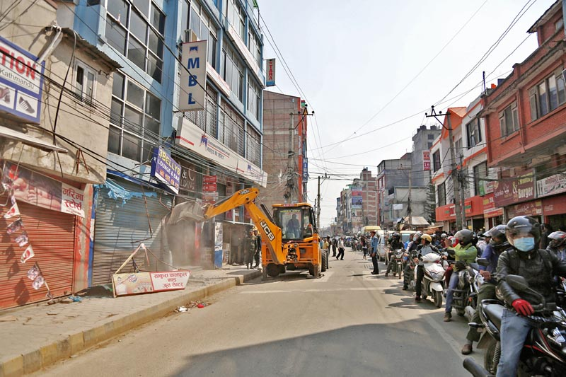 A bulldozer is being used to dismantle illegally built houses along the New Baneshwor-Shankhamul road section in Kathmandu, on Monday, April 10, 2017. Photo: RSS