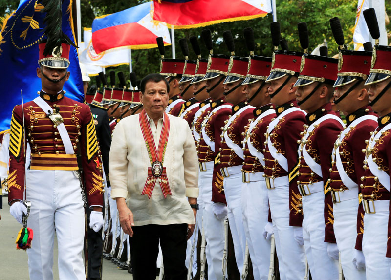 President Rodrigo Duterte reviews police academy graduates as he arrives to attend the Philippine National Police Academy (PNPA) graduation in Camp Castaneda, Silang town in Cavite city, south of Manila, Philippines on March 24, 2017. Photo: Reuters