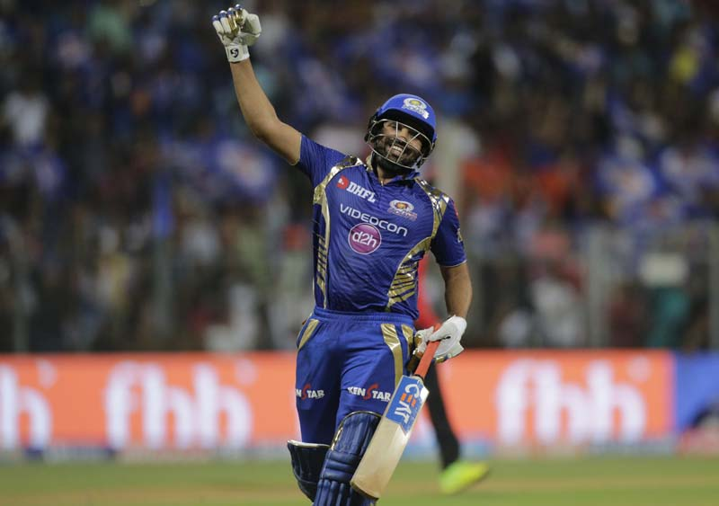 Mumbai Indians batsman Rohit Sharma celebrates after winning against Gujarat Lions during their Indian Premier League (IPL) cricket match in Mumbai, India, on Sunday, April 16, 2017. Photo: AP