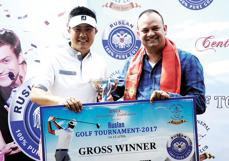 Director of Himayalan Distillery Pvt Ltd Raj Bahadur Shah handing over the trophy to Mithun Rai (left) after the Ruslan Golf Tournament at the RNGC in Kathmandu on Saturday, April 15, 2017. Photo: THT
