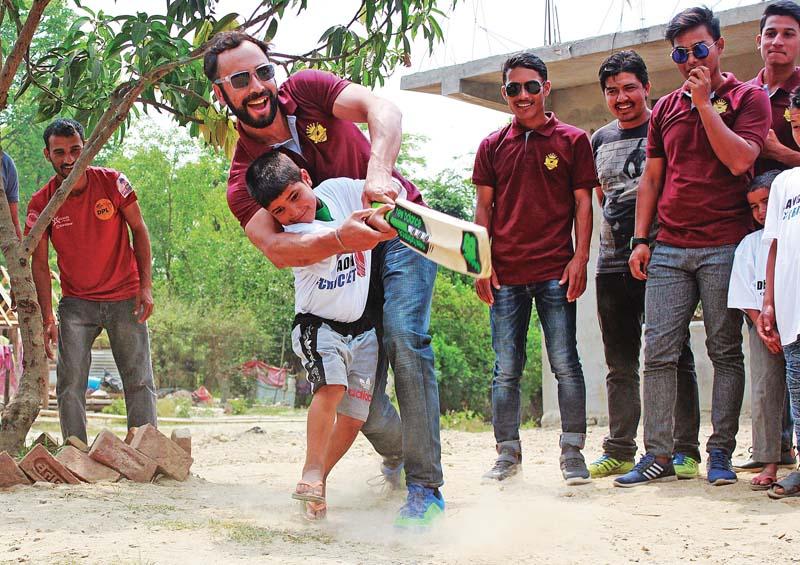 Biratnagar KIngs skipper Sharad Vesawkar teaches batting techniques to a student of Aama ko ghar hostel in Dhangadhi, on Tuesday, April 18, 2017. Photo: THT