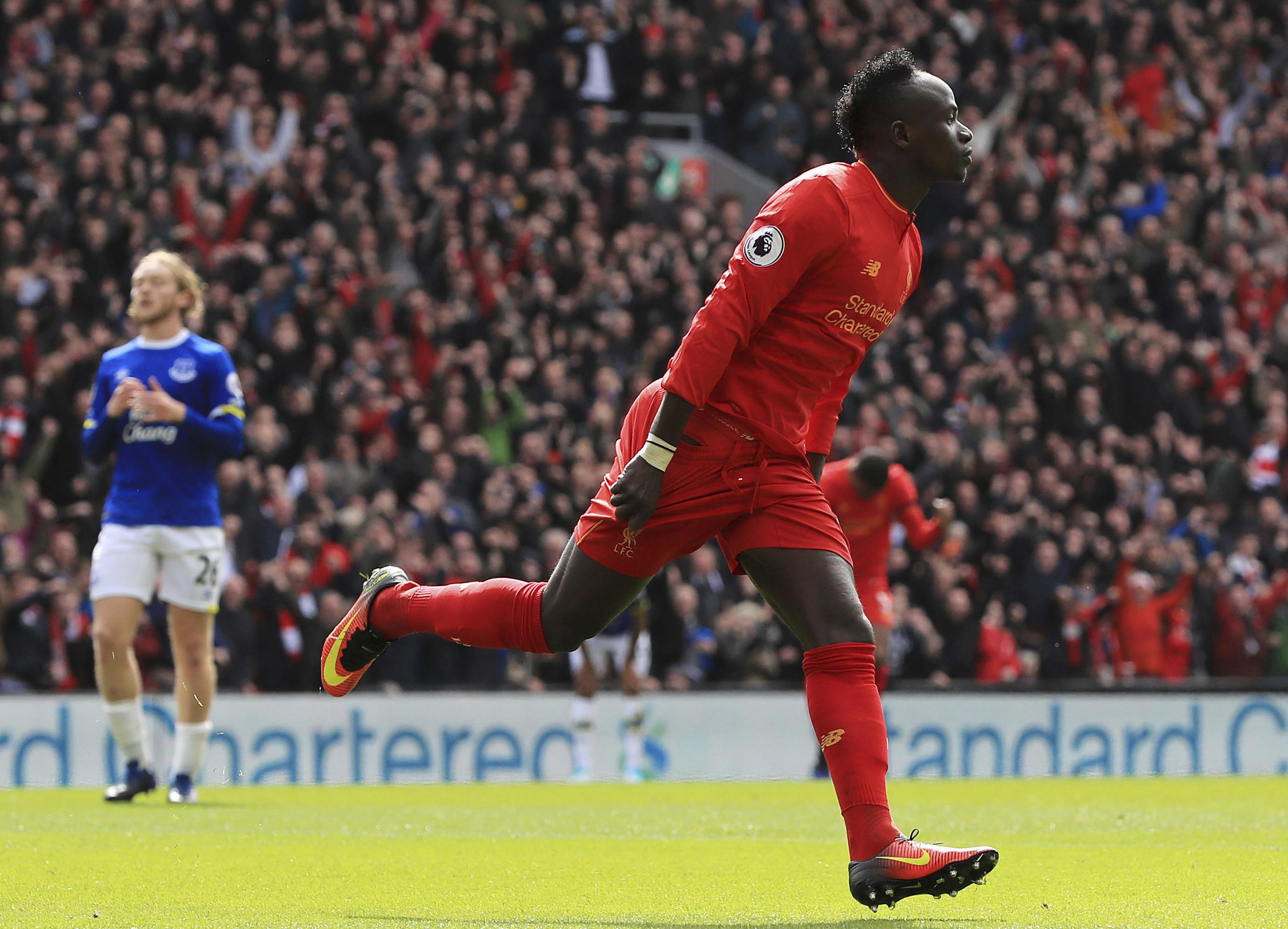 Liverpool's Sadio Mane celebrates scoring his side's first goal, during the English Premier League soccer match between Liverpool and Everton, at Anfield, in Liverpool, England, on Saturday April 1, 2017. Photo: AP