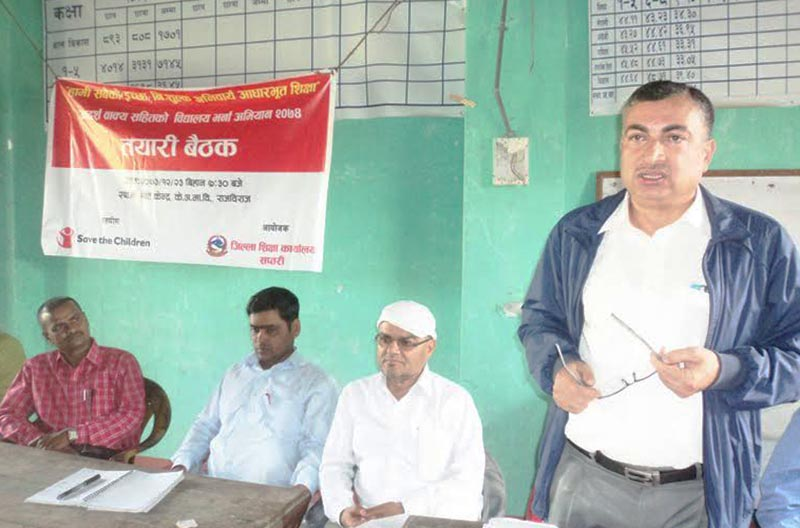 District Education Officer Dolraj Pande speaking at a meeting, organised by District Education Office, Saptari, about preparations for the School Admission Campaign 2017/18 in Rajbiraj, Saptari, on Wednesday, April 5, 2017. Photo: THt