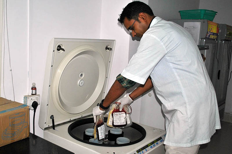 A lab technicians uses a Separater machine to classify blood group at a blood bank in Birgunj, on Thursday, April 20, 2017. Photo: RSS