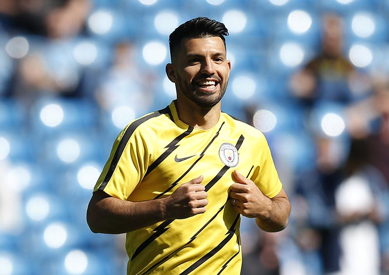Manchester City's Sergio Aguero warms up before the match. Photo: Reuters