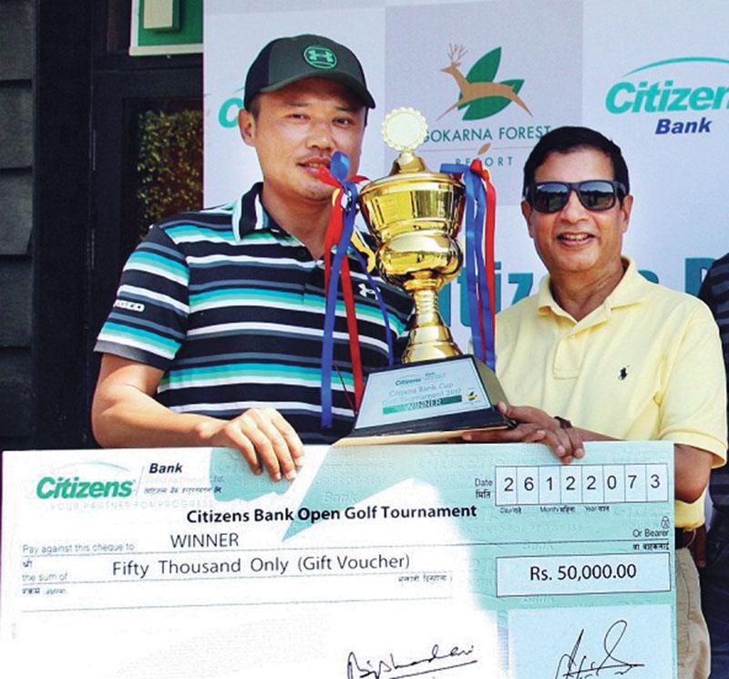 Dr Shankar Sharma, Chairman of Citizens Bank International Ltd, handing over the winner's trophy to Wangchen Dhondup (left) at the Gokarna Golf Club in Kathmandu on Saturday, April 08, 2017.