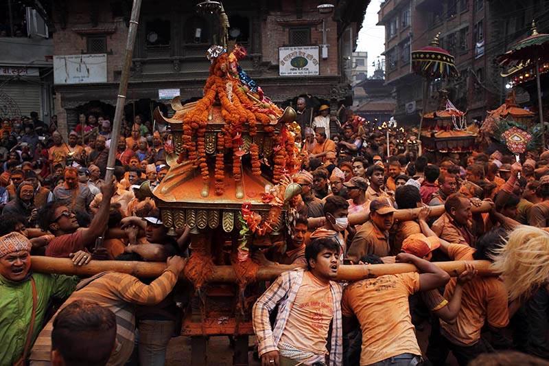 Devotees participate in a Sindoor Jatra festival in Bhaktapur, on Saturday. Photo: AP