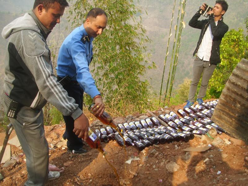 Panchthar District Police Office destroying smuggled liquor from the adjoining Sikkim on April 12, 2017. Photo: Laxmi Gautam
