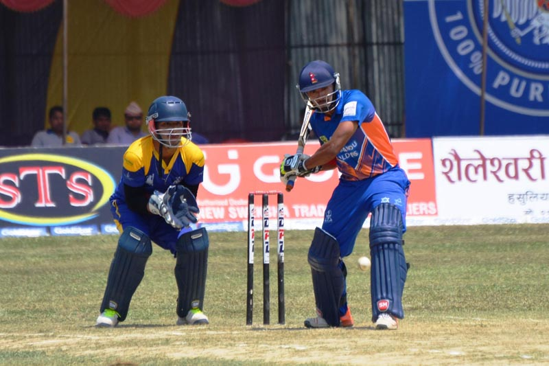 Sompal Kami shapes to hit a ball during the Dhangadhi Premier League, in Dhangadhi, on Monday, April 10, 2017. Photo: Tekendra Deuba