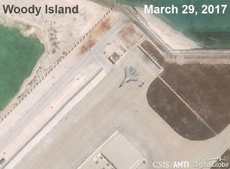 A Chinese J-11 fighter jet is pictured on the airstrip at Woody Island in the South China Sea in this March 29, 2017 handout satellite photo. Photo: CSIS Asia Maritime Transparency Initiative via Reuters