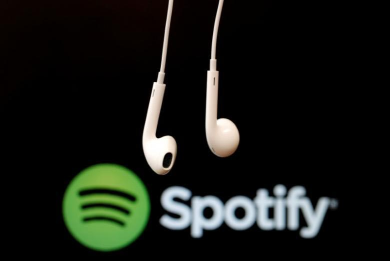 Headphones are seen in front of a logo of online music streaming service Spotify in this illustration picture on February 18, 2014. Photo: Reuters/File