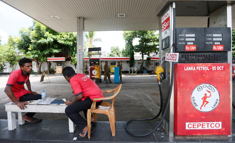 Workers rest next to a closed fuel filling point during an islandwide CEYPETCO (Ceylon Petrolium Corporation) strike at a fuel station in Colombo, Sri Lanka April 24, 2017. Photo: Reuters
