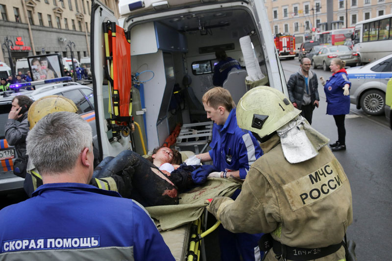 An injured person is helped by emergency services outside Sennaya Ploshchad metro station, following explosions in two train carriages at metro stations in St Petersburg, Russia, on April 3, 2017. Photo: REUTERS