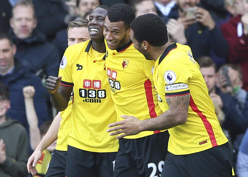 Watford's Etienne Capoue (centre) celebrates scoring his side's first goal dduring the Premier League soccer match between Watford and Swansea City at Vicarage Road, Watford, England, on Saturday April 15, 2017. Photo: Scott Heavey/PA via AP
