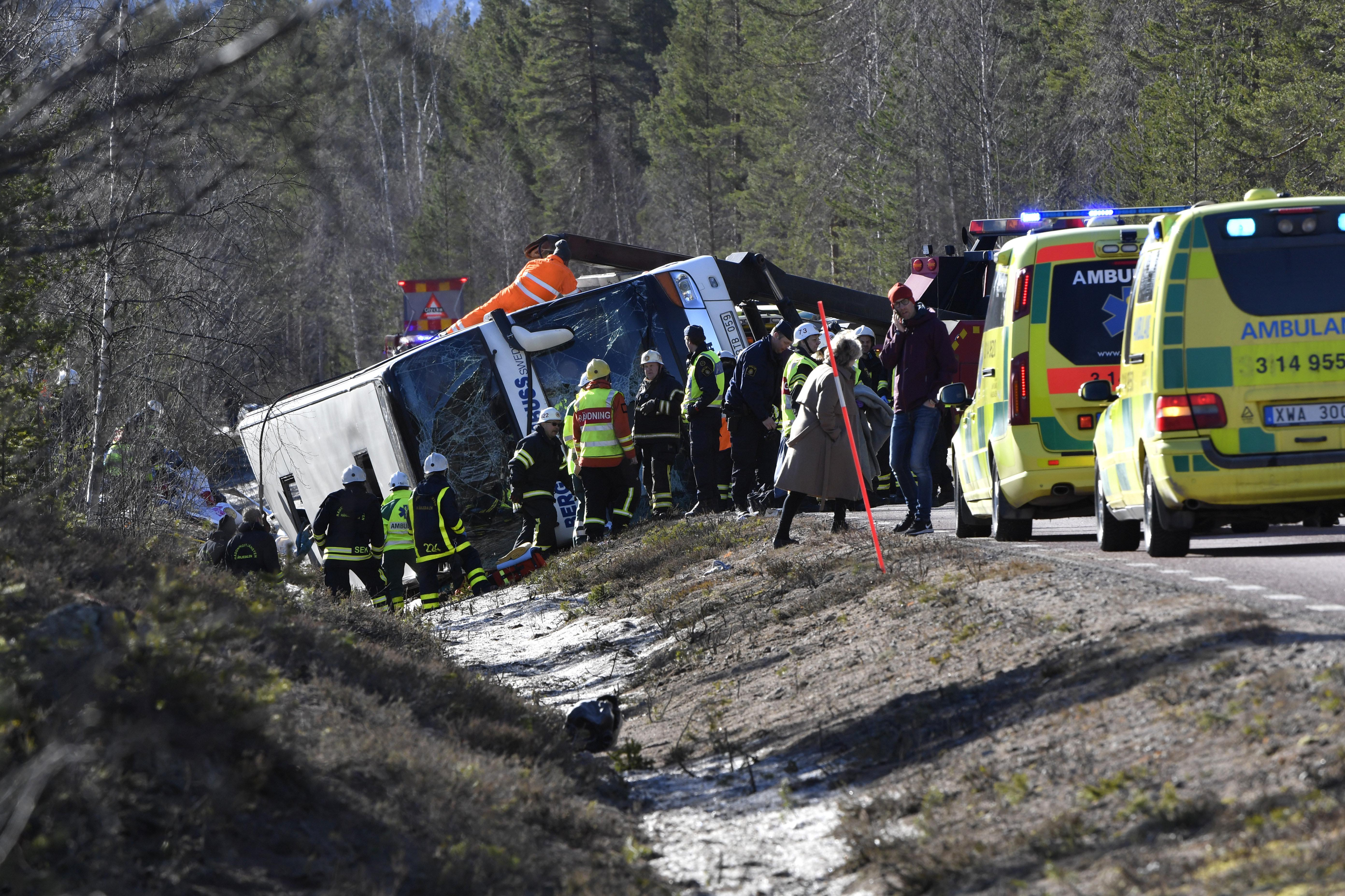 Emergency services and ambulance at the scene of a bus accident, on the E45 between Sveg and Fagelsjo in Sweden, on Sunday, April 2, 2017. ?Photo: Nisse Schmidt/TT via AP