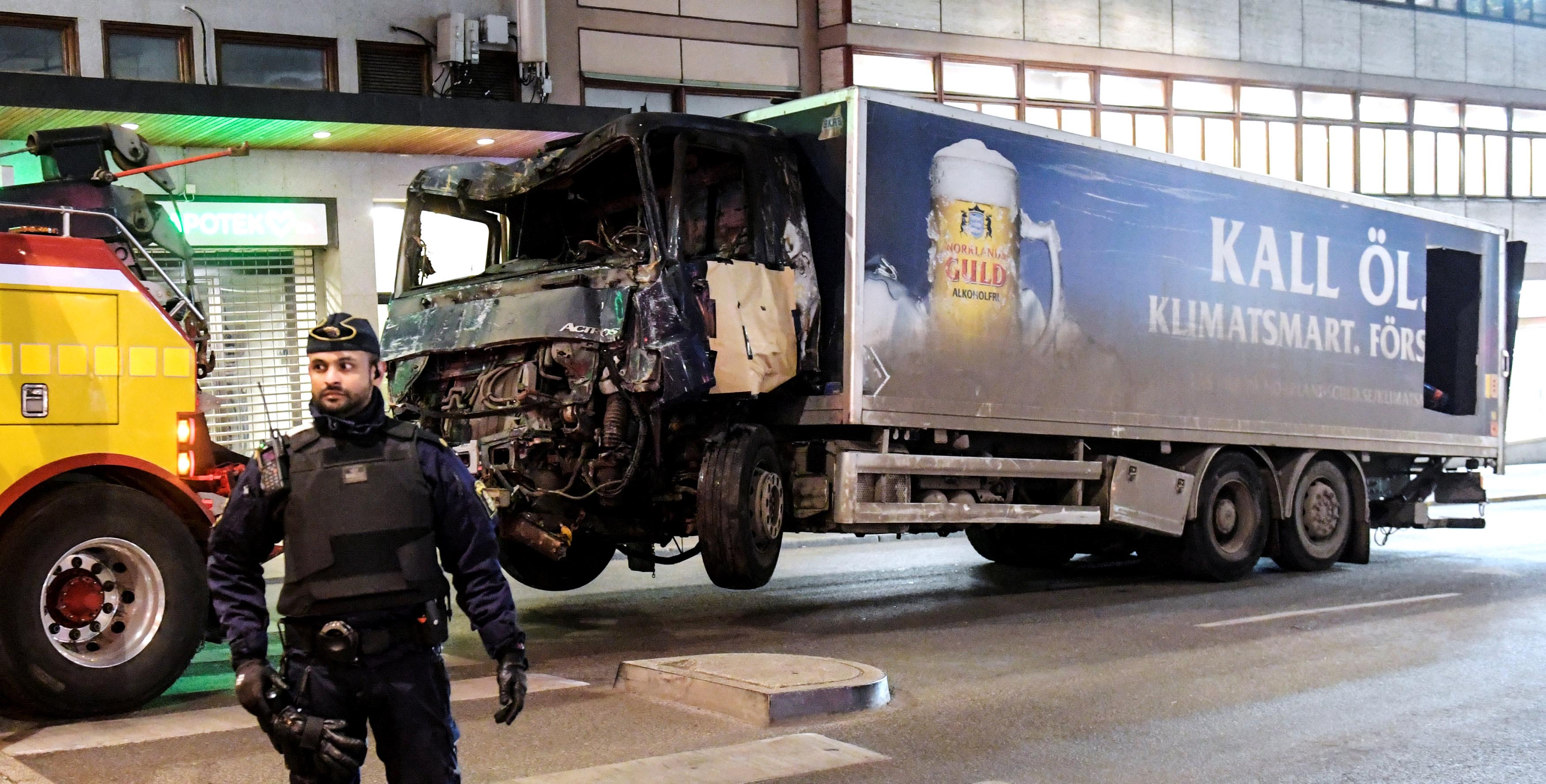 Tow trucks pull away the beer truck that crashed into the department store Ahlens after plowing down the Drottninggatan Street in central Stockholm, Sweden, on April 8, 2017. Photo: Maja Suslin/TT News Agency/via Reuters