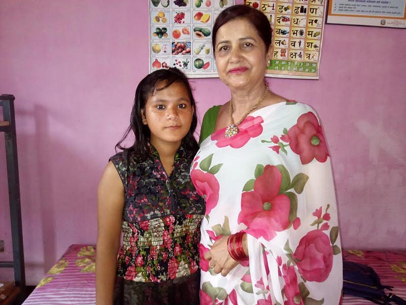Taniya Subba, who was separated from her parents, posing for a photo with Chairperson Bishnu Sharma at ABC Nepal office, in Biratnagar, on Wednesday, April 19, 2017. Photo: THT