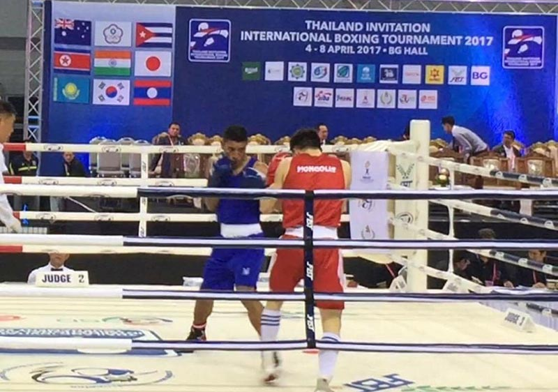 Nepalu2019s Deepak Shrestha (left) fights against Baatarsukv Hinzonrig of Mongolia during their first-round bout of the Thailand International Boxing Championship in Bangkok on Tuesda, April 4, 2017.